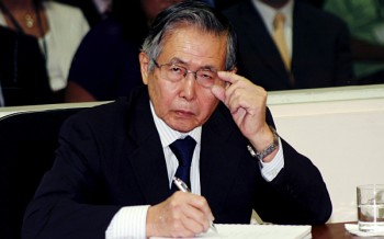 Peru's Former President Alberto Fujimori listens to the judge during the reading of the sentence of his trial at the special police headquarters in Lima April 7, 2009. Former Peruvian President Alberto Fujimori was convicted of human rights crimes on Tuesday, the first time a democratically elected Latin American president was found guilty in his own country of rights abuses. A three-judge panel convicted him for ordering a military death squad to carry out two massacres that killed 25 people during his 1990-2000 rule, when he was battling guerrillas. Nearly 70,000 people died in two decades of conflict in the Andean country. REUTERS/Francisco Medina/Justice Palace/Handout (PERU POLITICS CONFLICT SOCIETY)
